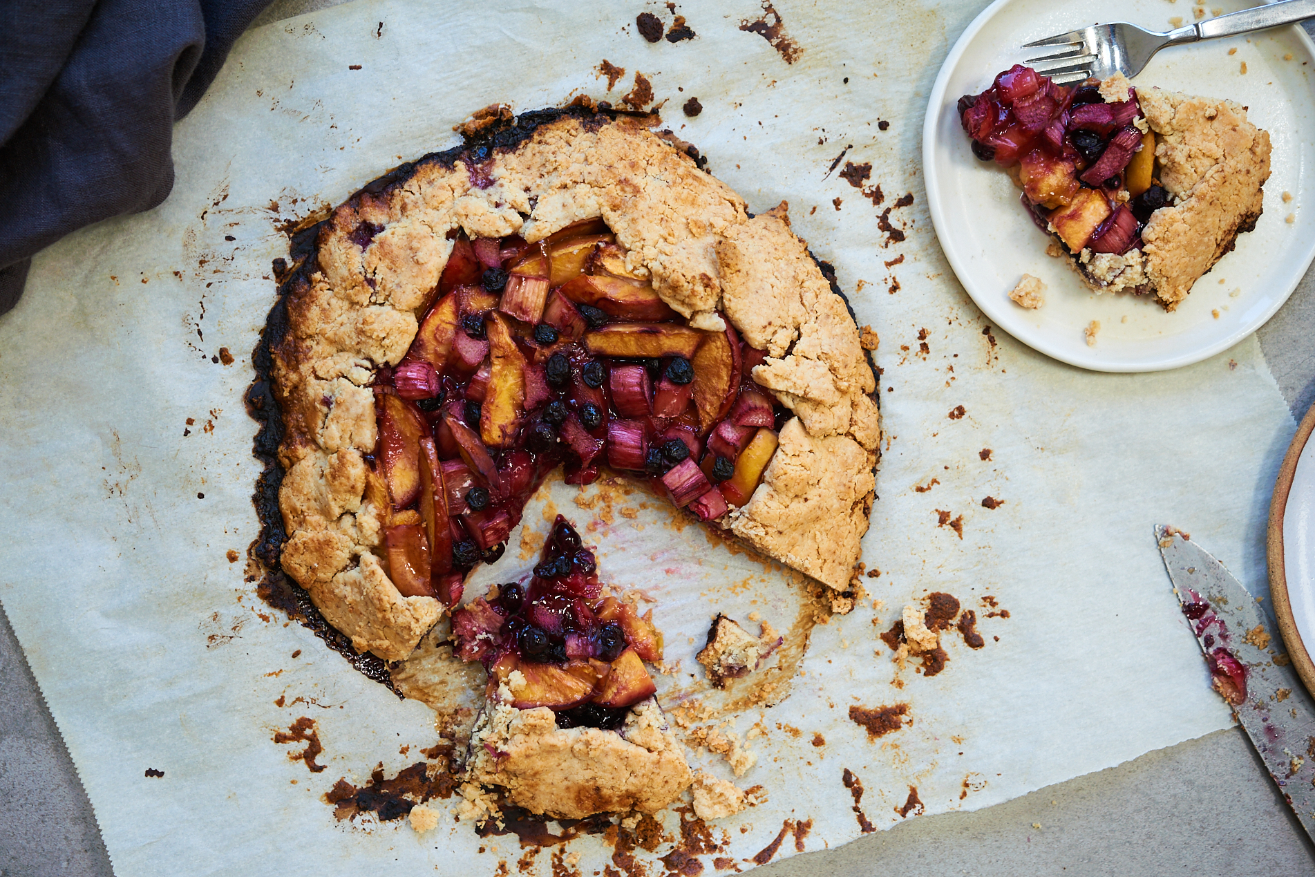 This gluten free and paleo galette is filled with rhubarb, peaches and blueberries. It is sugar free and sweetened with coconut sugar and uses almond flour and tapioca.