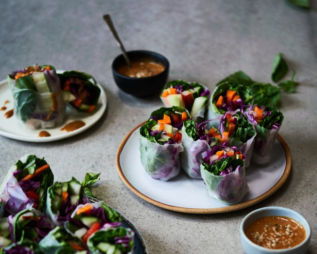 These summer rolls are made with rice wraps and lots of vegetables and herbs with almond butter dipping sauce.