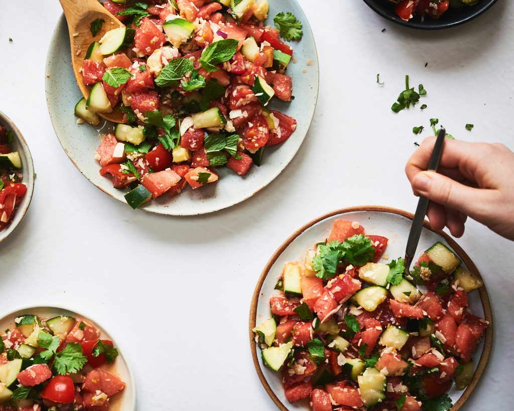 this watermelon salad is dairy free, vegan and gluten free. It's made with watermelon, cucumber, tomato, mint and fresh herbs and is a really delicious salad.